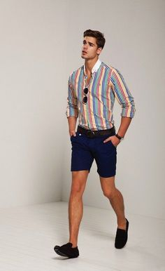 Shop this look on Lookastic: https://lookastic.com/men/looks/dress-shirt-shorts-tassel-loafers-belt-sunglasses-watch/12685 — Multi colored Vertical Striped Dress Shirt — White Sunglasses — Dark Brown Leather Belt — Dark Brown Leather Watch — Navy Shorts — Dark Brown Suede Tassel Loafers