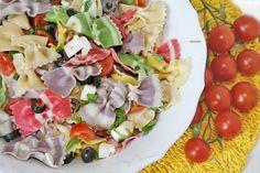 Ricetta Farfalle primavera con pomodorini, mozzarella rucola e olive
