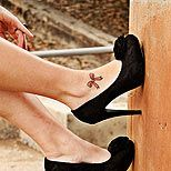 Ankle bow tattoo