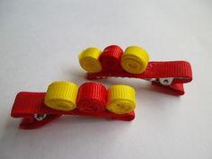 Presilha rolinho vermelha e amarela