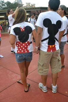 Disney couple's shirt with mickey and minnie holding hands on the back