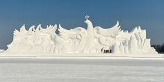 Changchun, China Workers shape a huge snow sculpture at a park in Jilin province where over 200 snow sculptures are on display