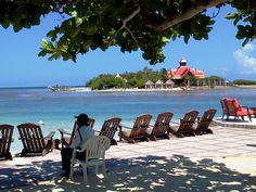 On the beach at Sandals Royal Caribbean with a view of the Private Island in Montego Bay, Jamaica.