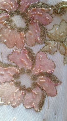 New Sample: Aurelia detail image of hand painted & beaded lace over silk tulle created by Chantal. www.18thcenturycorsets.com #Aurelia #handbeading #wedding #weddingdress #bridalgown #vintage #apricot #peach #ivory #lace #appliqué