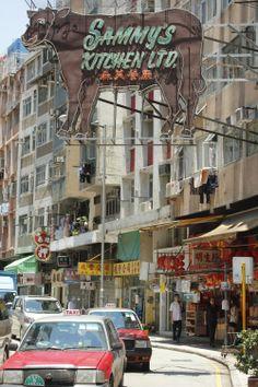 View of the neon sign of Sammy's Kitchen in Sai Ying Pun, Hong Kong. (Photo: Doug Meigs)