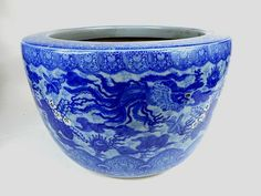 """Ceramic Japanese hibachi decorated in dragon and floral design motif. 12""""H x 19""""W"""