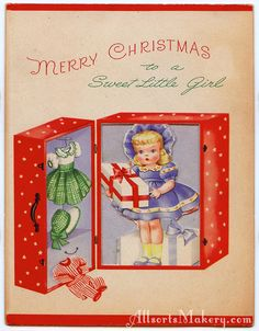 """Vintage """"Merry Christmas to a Sweet Little Girl"""" Christmas card with a doll in case with doll clothes. The look is 1940s or 1950s."""