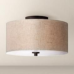 3 Upstairs Bedrooms | Tailored Elegance - A fabric drum shade textured in an oatmeal and off-white weave give this bronze finished ceiling light a look of tailored distinction.