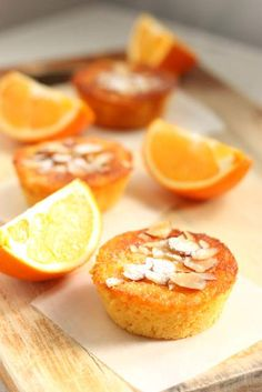Orange and Almond Cakes: 2 large sweet navel oranges, washed - 1/4 cup white sugar (optional) - 2 1/2 c. ground almonds- 1 1/4 cups caster sugar - 1 teaspoon baking powder - 5 eggs - flaked/sliced almonds to decorate. Makes 24 mini cupcakes.