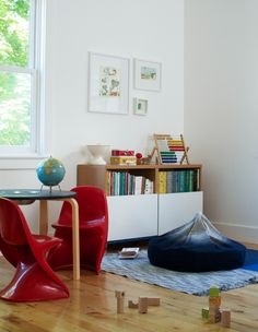 Living With Kids: When designing their spaces and our shared spaces, I try to incorporated their interests and make it a fun environment where they can freely express and be creative. My daughter is still too young to notice, but my son loves it when I hang or display his artwork or clay figures. It makes him feel like he is contributing to the home, and he is.
