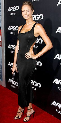 STACY KEIBLER Temporarily sans her best accessory – boyfriend George Clooney – Stacy still manages to turn heads at the Beverly Hills Argo premiere in a backless black dress accentuated with strappy sandals, a small clutch and a simple updo.