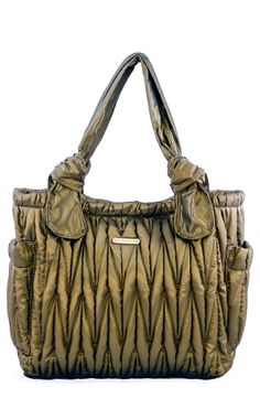 This #bronze quilted diaper bag is beyond elegant.