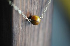 This single Tiger's Eye 14k gold necklace is perfect for a wear with anything piece of jewelry.  The 16 inch length is perfect.  By LaceCharming