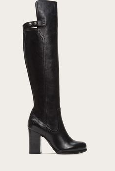 The ultimate street stunner. Statuesque, this boot is handcrafted with pull up leather that is antiqued and burnished for an unforgettable hue. The buttoned strap behind the knee adds a chic element and the front can be folded over at whim. With a stylish sheath or vintage denim, this boot was made to be photographed.