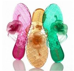 by Chanel .they look like candy.like you could just eat them.like gummy bear candy. Jelly Shoes, Jelly Sandals, Flip Flop Sandals, Coco Chanel, Gummy Bear Candy, Karl Otto, Glitter Flip Flops, Glitter Jelly, Shoes