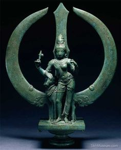Trident with Shiva as Ardhanari (Half-Woman)  ca. 1050, Chola dynasty, South India. A Shiva sculpture almost a thousand years old can easily be mistaken for the Sikh Khanda emblem. To learn more see the SikhMuseum.com Exhibit - Nishan Sahib, History of the Sacred Banner and its Symbols