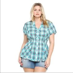 Hello Cowboy! Cute blue plaid shirt! I would totally keep this but I'm to busty!!! Torrid size 1. torrid Tops