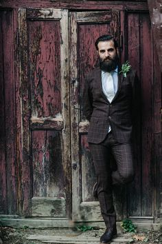 ShaFox.com For the nontraditional wedding couple, don't be afraid to stray from black or gray for your groom's wedding day attire. This fitted, brown, plaid suit is a nod to both vintage and modern styles!