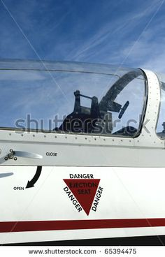 Closeup of a jet fighter eject seat warning - stock photo