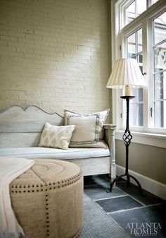 Modern interior design with white painted brick wall invites the eye to stop and notice unique texture, brick pattern and bright accents in a room, without which neutral colors can appear plain and lacking interest.