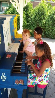 """The Munoz family enjoy Pianos inPublic  Jessica Munoz sent this """"family pic"""" from one of the world famous Pianos in Public Buffalo…It's a great shot, and is indicative of the project's purpose— to have anyone, including kids, not be afraid to touch a piano and see what happens."""
