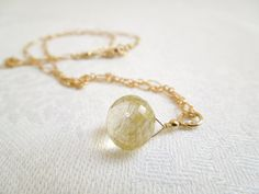 """This is one of mine...""""they"""" say rutilated quartz is good for focus and enhancing energy. I don't know about THAT...but it IS pretty!  Rutilated Quartz Pendant Necklace Delicate Gold by seemomster"""