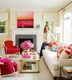 """""""A little color goes a long way,"""" is Brooke Shields' decorating philosophy. In her living room, she covered floral chintz chairs inherited from her mother in hot pink with white trim. For a calm, happy backdrop, she painted the entire first floor buttery yellow."""