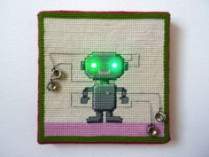 """New media student Anu Koski created this clever combination of needlepoint and LEDs with her """"Needlepoint Robo."""
