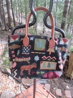 Vintage Orvis tapestry tote with leather straps and very clean canvas lining Outdoor theme moose trees and all types of symbols. Excellent by MrsHummelsBasement on Etsy