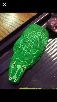 Allegations crocodile painted rock #rimrocks