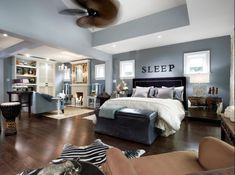 """candice olson bedroom design. Love the wall colour- van courtland blue, and the """"sleep"""" decore. Not to mention the living room and fireplace, wicker ceiling fan and african art!"""