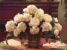 Cream Rose Hydrangea Elegant Silk Floral AR228-99. This beautiful classic design is one of our best sellers and can be custom designed in many different color schemes to match your home's decor. Warm cream hydrangeas and roses add an elegant charm to your home set in this scalloped antique gold finish bowl.