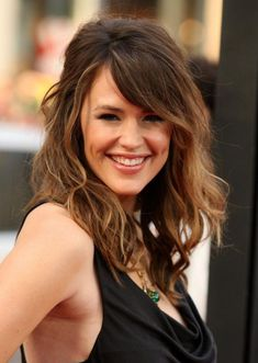 Modern Style For Medium Long Hairstyles With Bangs This Style Is Good For Natural Wavy Hair Or You Can Use Hair Iron For The Wavy Impression : Charming Style For Girls Hair Designs With Some Inspiring Samples - See and learn how to style 2015 most popular hairstyles