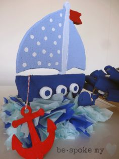 Ahoy it's a Boy Baby Shower Theme handmade blue sailboat made from Styrofoam, tissue paper and wood pieces for the Anchor and Whale. Party Decoration for the Serving Table.