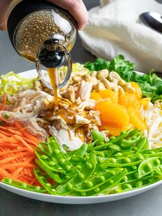 A healthy Chinese chicken salad full of crunchy veggies like cabbage, carrots, sprouts, and snap peas! Serve with a light, flavorful soy sesame dressing! Asian Chicken Salads, Chinese Chicken, Cooking Chicken To Shred, How To Cook Chicken, Healthy Salads, Healthy Eating, Healthy Recipes, Easy Asian Recipes, Ethnic Recipes