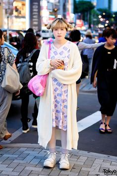 """Asako on the street in Harajuku wearing a #vintage #Nordstrom dress from Kinji under a long Kastane(カスタネ) knit sweater and #Tokyo Bopper """"milk crown"""" #platforms."""