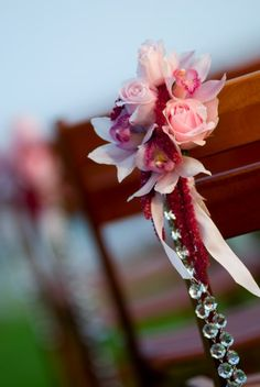 Simple Ceremony Decor - Cymbidiums and roses with a strand of hanging crystals.