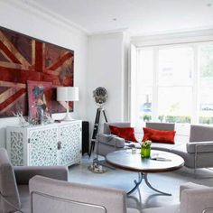 Like the giant, distressed Union Jack, make that a focal point and the only British thing so the basement doesn't turn into a TGIFriday's.