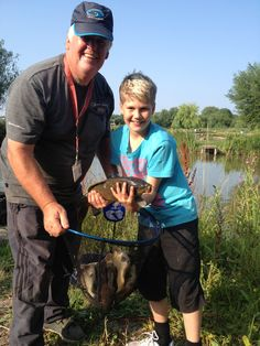 Fishwish coach Steve Jackson with one of the children taking part in a junior coaching day