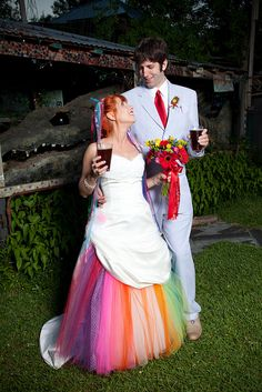 Check out the way this conventional white wedding dress has been turned into a rainbow explosion