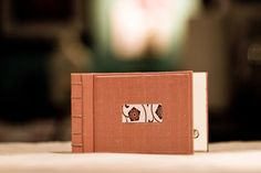 Custom wedding album maker; pictured was one of a set of twelve small guest books that matched the wedding decor and were distributed one-per-table so guests could write at their leisure.