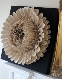 Like a paper dahlia, but looks like it's done with felt instead? Hmm!