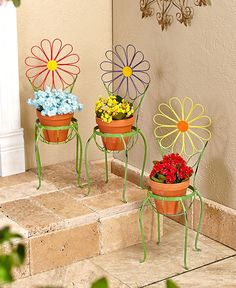 Cheer up your deck, porch or patio with a Flower Chair Plant Stand. The stand's sturdy metal frame has a whimsical design with a weathered finish and can easily