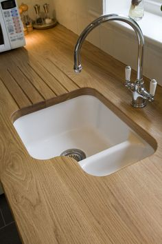Like this sink and the drainer routed into the worktop. Also love the no up-stand look.