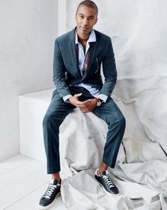 How it's done at J.Crew: sneakers with a suit. Comic book kicks are great for the gym, but when dressing up, you want a clean, monochromatic pair that compliments an Italian corduroy suit. To pre-order, call 800 261 7422 or email verypersonalstylist@jcrew.com.