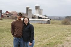 Daniel and Allison Cooper pose with the farm behind them.