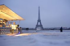Credit: Kenzo Tribouillard/AFP/Getty Images People walk on the snow covered Esplanade du Trocadéro near the Eiffel tower