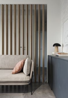 timber screen, room divider, herringbone rug, cloud sofa, sofa on metal legs, contemporary interior, living room design, brick finish wall
