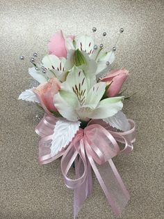 Pink and white corsage perfect for a soft colored prom dress. Alstroemeria and spray roses