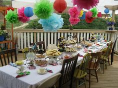 mad hatter tea party ideas | The tablescape came together beautifully! The tissue paper pom poms ...